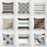 decorative sofa pillows with striped patterns in brown and blue
