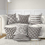 brown, beige and gray throw pillow with geometric design