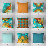 teal and orange outdoor pillows with abstract designs