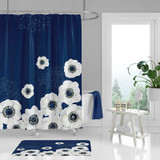 Blue floral shower curtain and bath mat with large white flowers.