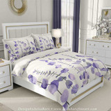 purple and white watercolor duvet cover with tropical leaves