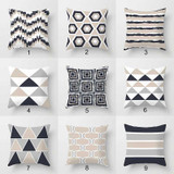 collection of geometric throw pillows in beige, gray and white