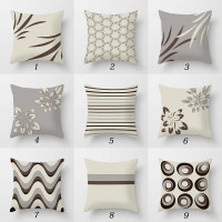 collection of throw pillows in beige, gray and brown