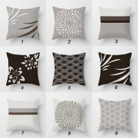 gray and brown cushions with geometric design