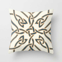 decorative pillow with white, blue and brown geometric pattern