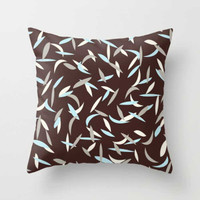 brown and blue decorative pillows