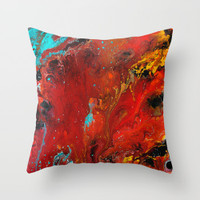 bright red and turquoise cushion cover