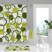 green and white shower curtain and bath mat