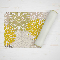 mustard yellow and green bath mat with floral design