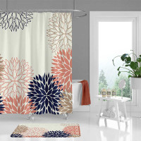 pink and blue floral shower curtain and bathroom rug