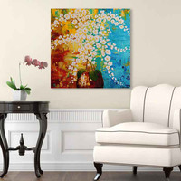white orchid painting on turquoise and yellow brown background