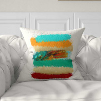 bright colorful throw pillow in red, turquoise, teal and orange
