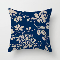 dark blue and beige floral throw pillow