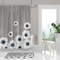 beige shower curtain with large white flowers