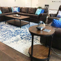 geometric throw pillows in blue and turquoise on the couch