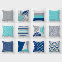 collection of throw pillows in dark blue, gray and turquoise