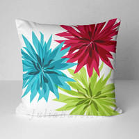 colorful floral throw pillow with large flowers in teal, green and red