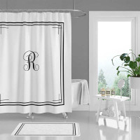 Custom monogram shower curtain and bath mat in black and white