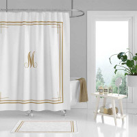 white and golden yellow monogram shower curtain and bath mat set