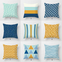 designers collection of dark blue, light blue and yellow pillow covers