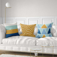 decorative cushions in blue, yellow and mint green