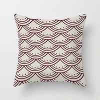 designer pillow with red and beige pattern