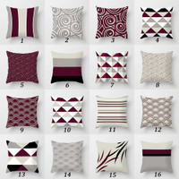 dark red, gray and black throw pillows with original designs