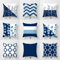 blue and white throw pillows with floral and geometric patterns