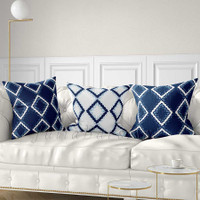 geometric pillows in blue and white