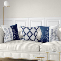 floral and geometric decorative pillows in blue and white