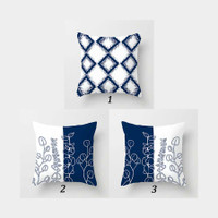 blue and white throw pillows with geometric and floral patterns
