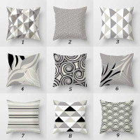 collection of gray black and white decorative pillows by Julia Bars