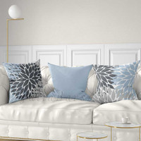 gray and light blue decorative pillows with floral patterns