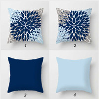 blue and gray floral pillows