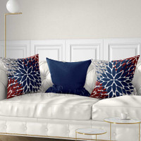 red, gray and blue decorative pillows with floral patterns