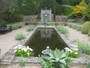 Landscape use in mirror pond leading to trompe l'oeil in Mrs. Lea's garden on the Island of Jersey