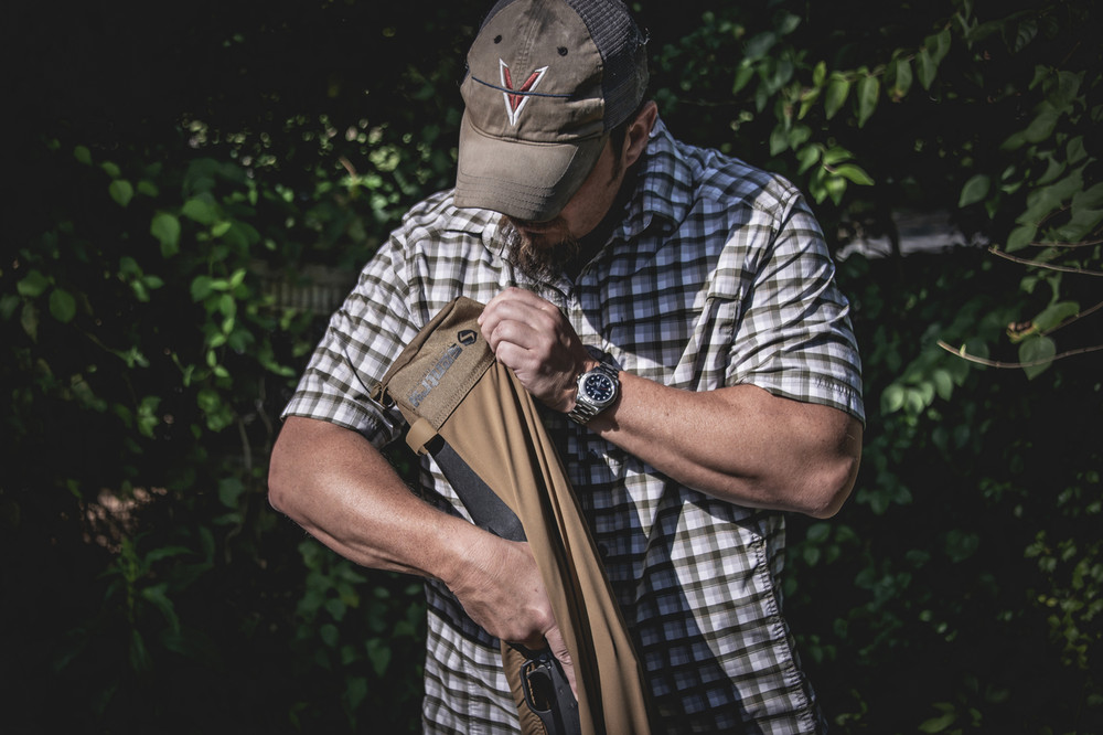 Rifle or Shotgun slides in barrel first then it stretches just a little to go over the stock and provides a secure water resistant cover.