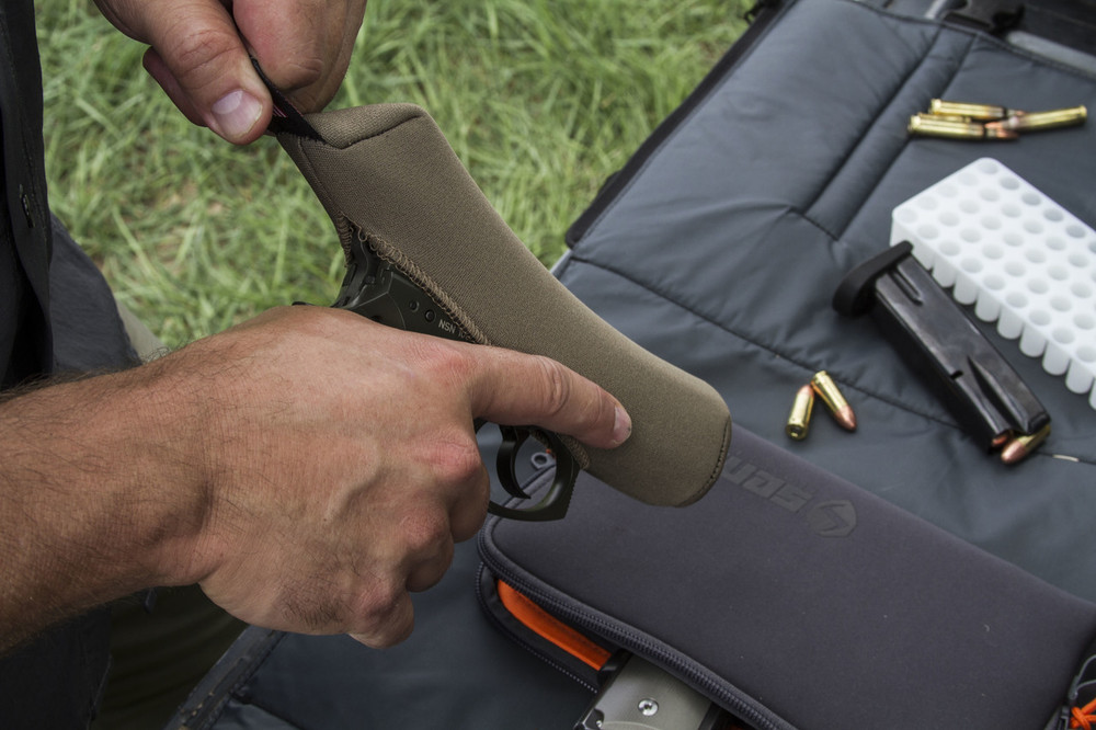 Easily use the pull tab on the rear of the cover to remove or install on your handgun.