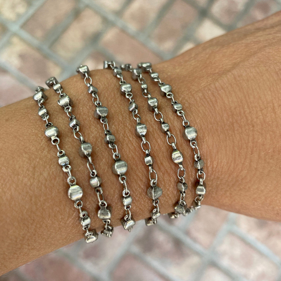 Fully adjustable chain wraps as a bracelet!