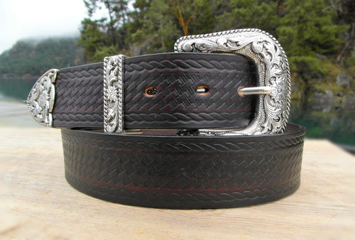 Western leather belt with silver buckle.