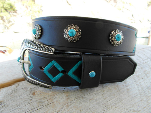 Turquoise stones on black belt.