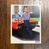 Autographed Tom Wopat  8x10 Photo sitting on General Lee
