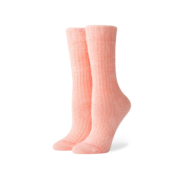 Three quarter view of  Stance Peachy Keen socks in peach color on model's feet