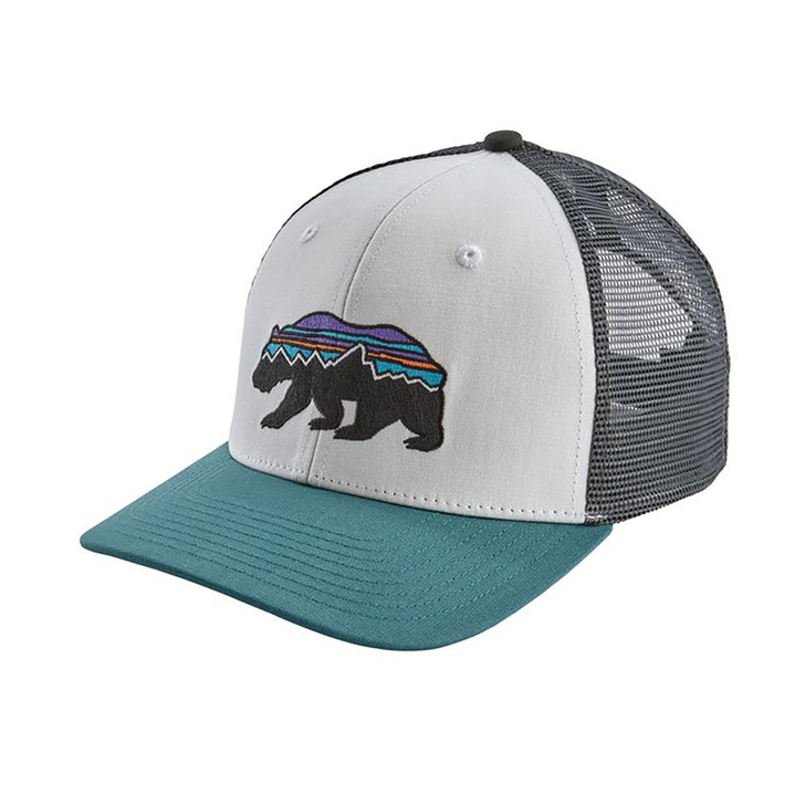 Three quarter view of Patagonia Fitz Roy Bear Trucker hat in white with teal brim