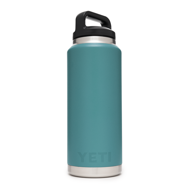 Side view of Yeti 36 ounce Rambler Bottle in River Green color with black handle cap