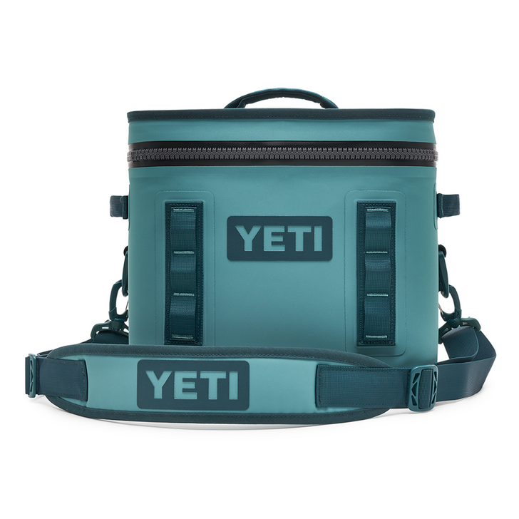 Front view of Yeti Hopper Flip 12 Cooler in River Green with carry strap