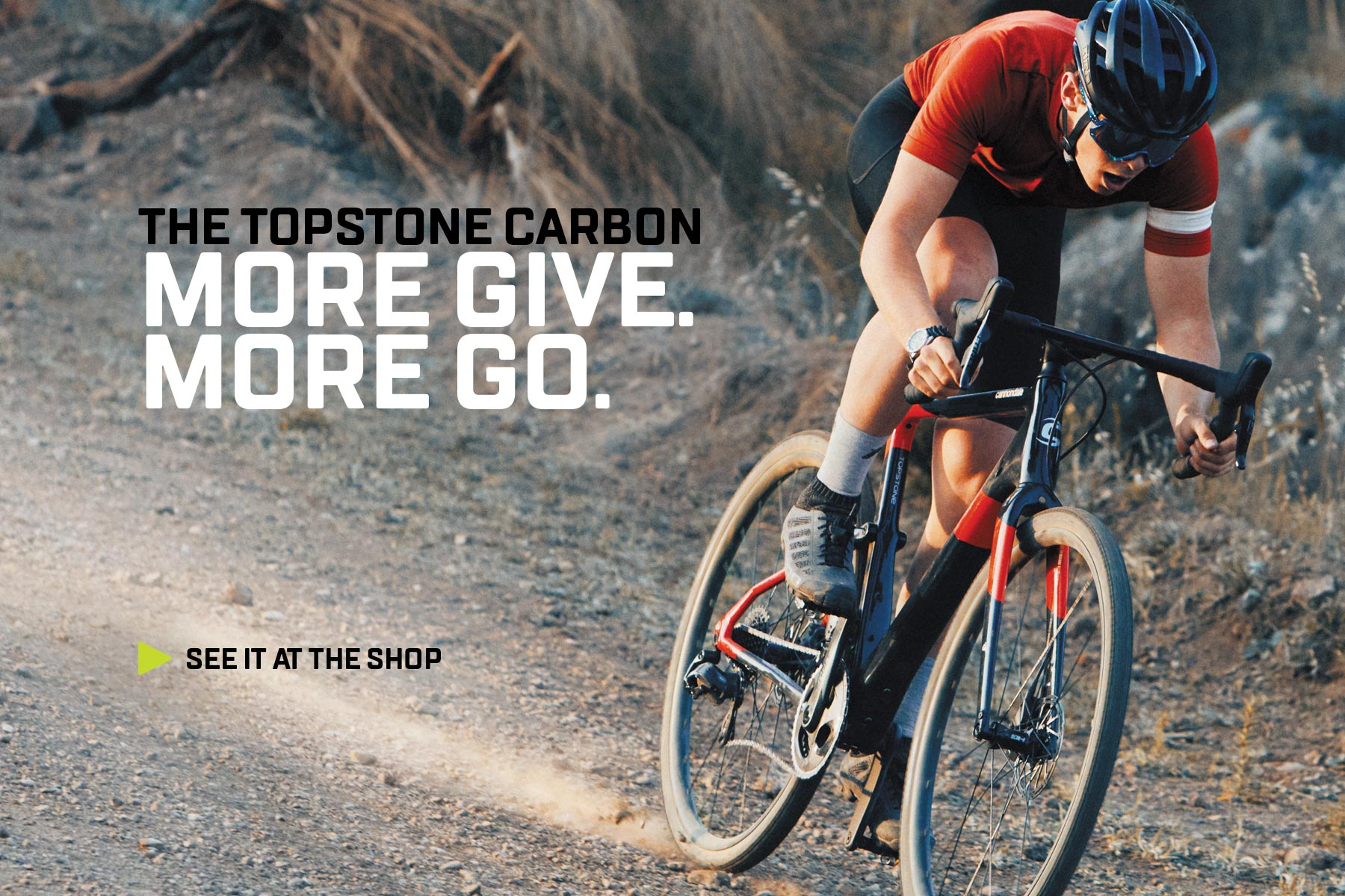 The Cannondale Topstone rolling down a gravel road.