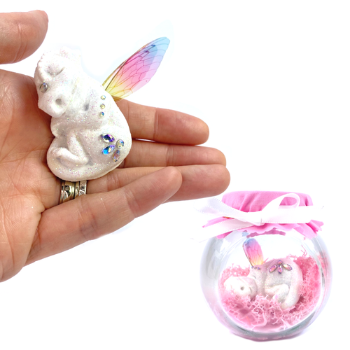 White baby dragon with rainbow wings