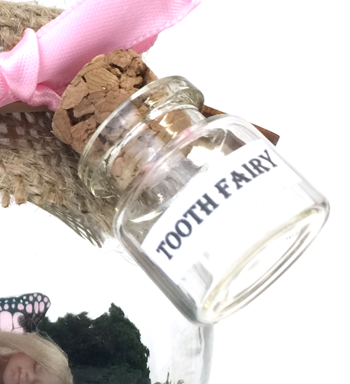 Our new tooth fairy jars now have glitter and ribbon