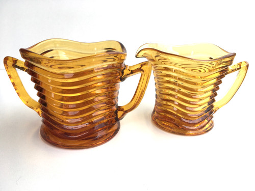 Art Deco Swirl Patterned Amber Glass Sugar Bowl and Creamer